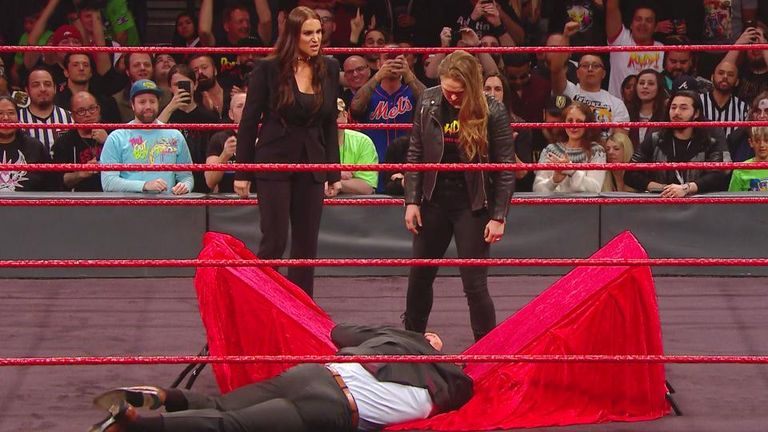 Rousey looks on after throwing McMahon's husband Triple H through a table at Elimination Chamber