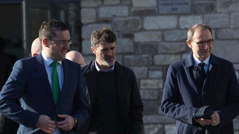 Roy Keane and Martin O'Neill  arrive for the funeral at St John the Baptist Church