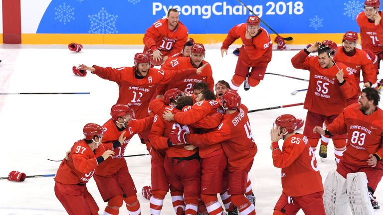 Olympic Athletes from Russia celebrate after defeating Germany 4-3 in the ice hockey final