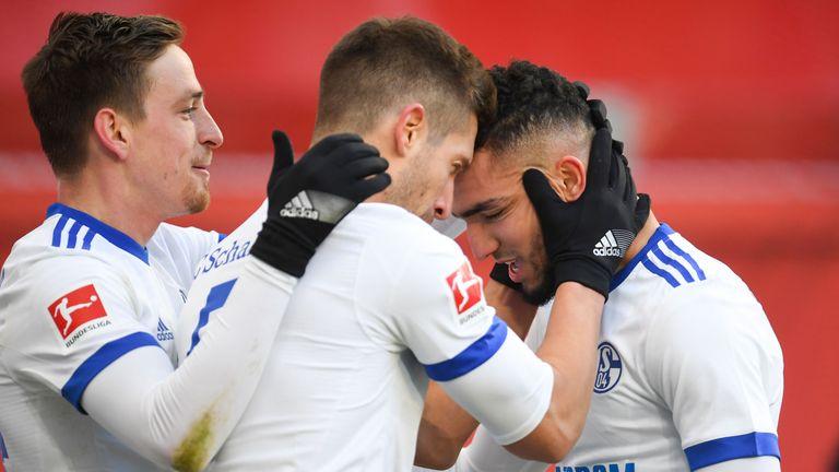 Nabil Bentaleb is mobbed after his strike for Schalke against Bayer Leverkusen