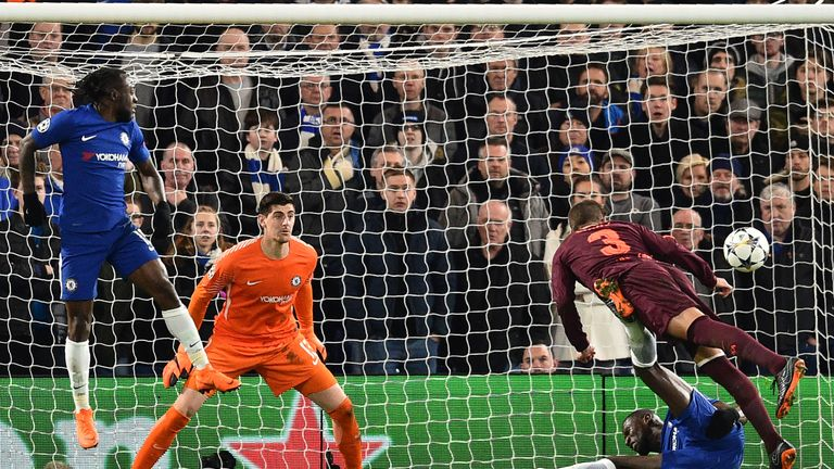 Thibaut Courtois in action against Barcelona