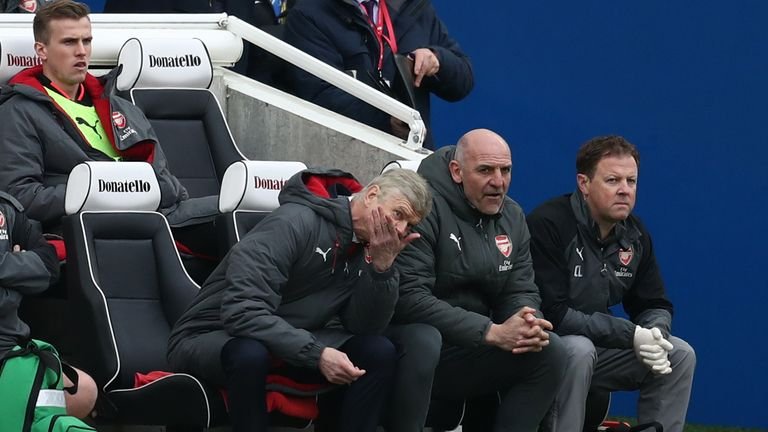 Arsene Wenger looks on as his side lose at Brighton
