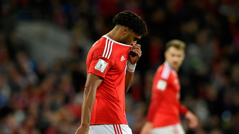 Ashley Williams of Wales looks dejected after defeat to Ireland