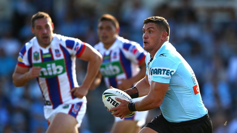 Chris Heighington looks to run the ball for the Newcastle Knights