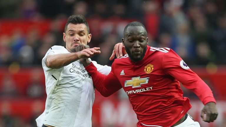 Dejan Lovren tussles with Romelu Lukaku during the game