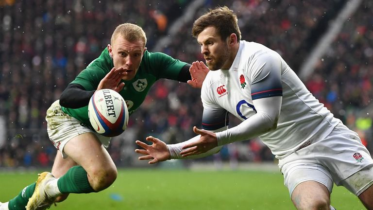 Keith Earls attempts to stop England's Elliott Daly from scoring