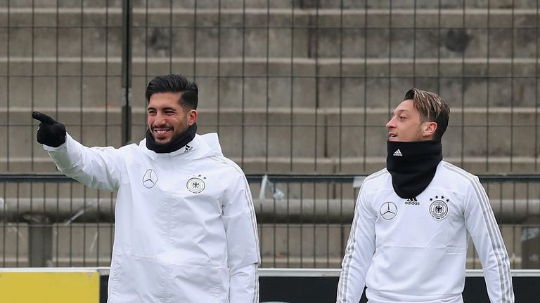Ozil, pictured with Germany teammate Emre Can, is confident of being fit enough to play in Russia