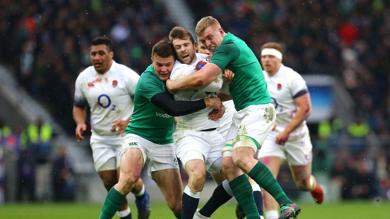 England's Elliot Daly (C) is tackled by Ireland's Dan Leavy (R) and Jacob Stockdale (L)