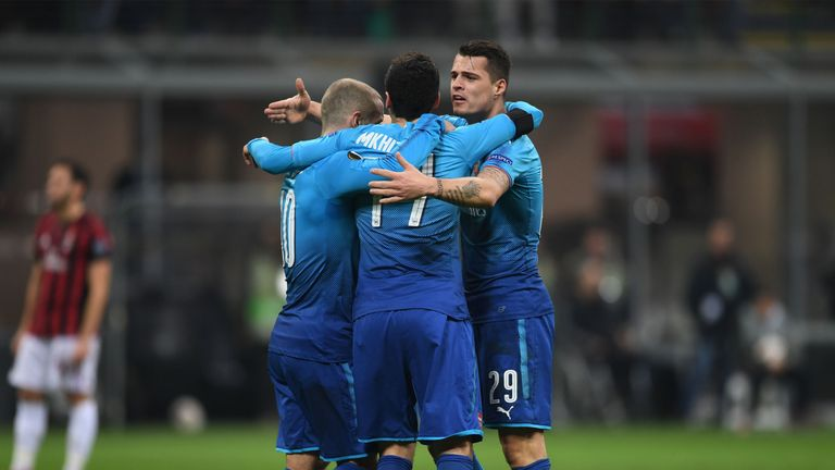 Arsenal ended a four-game losing run with a valuable 2-0 first-leg victory over AC Milan in the Europa League last 16