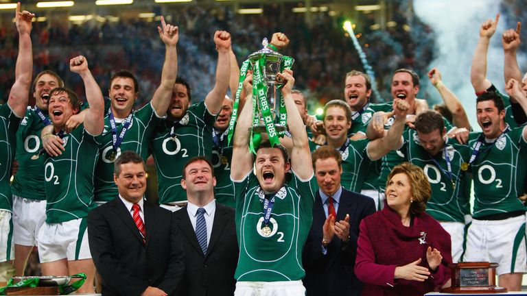 Brian O'Driscoll lifts the trophy after a dramatic final clash with Wales