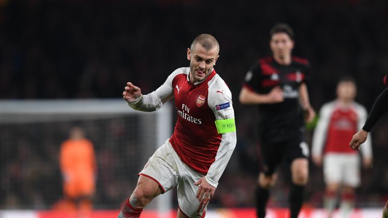 Jack Wilshere drives forward for Arsenal against AC Milan