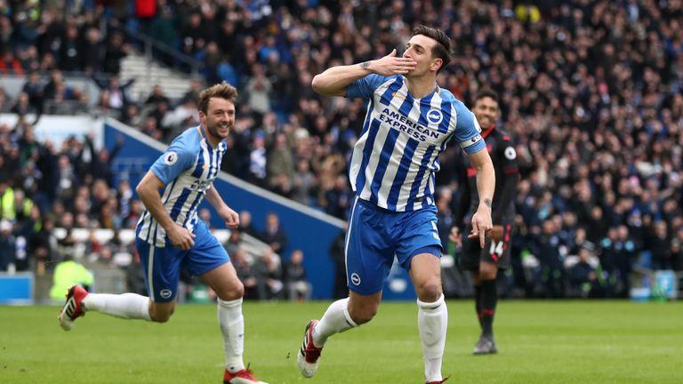 Lewis Dunk celebrates scoring Brighton's first goal against Arsenal