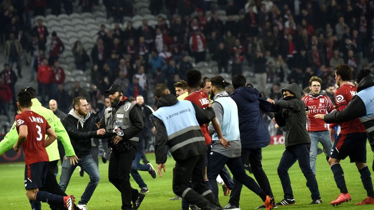 Lille fans invaded the pitch at the Stade Pierre-Mauroy on Saturday