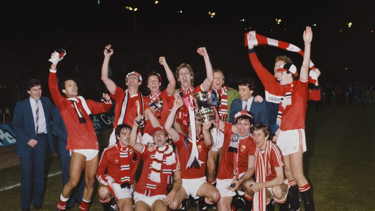 Ray Wilkins (back row, far left) celebrates winning the 1983 FA Cup Final replay against Brighton with his Manchester United team-mates