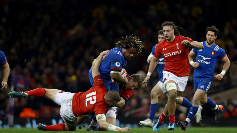 Dan Biggar  and Hadleigh Parkes bring down  Mathieu Bastareaud