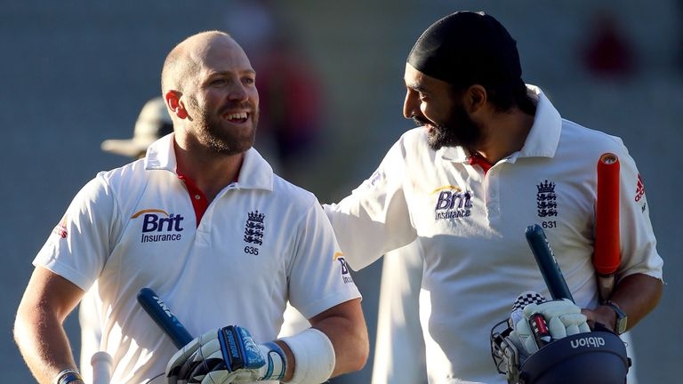 Matt Prior and Monty Panesar celebrate after holding on for a famous draw at Auckland