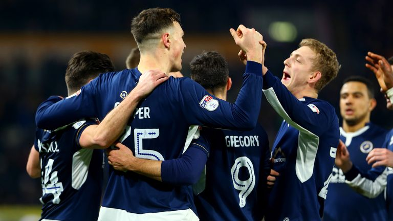 Millwall - celebrating here against Hull earlier this month - have equalled their record run of away wins