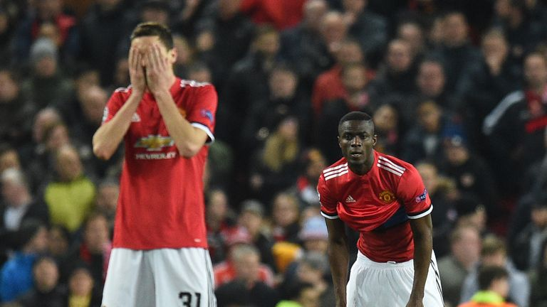Nemanja Matic (L) and Eric Bailly react after Sevilla scored their second goal against Manchester United