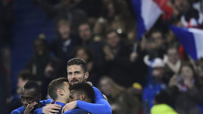 Olivier Giroud celebrates scoring against Colombia