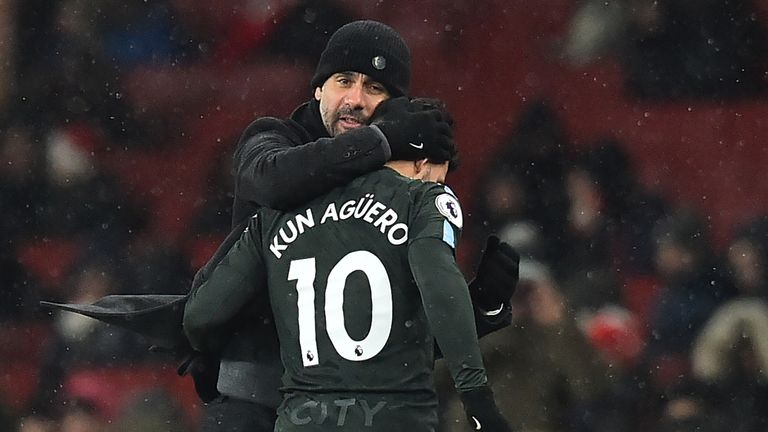Pep Guardiola embraces Sergio Aguero as he is substituted