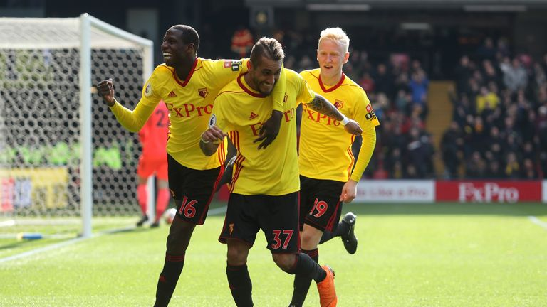Hughes (right) celebrates Roberto Pereyra's goal against Bournemouth