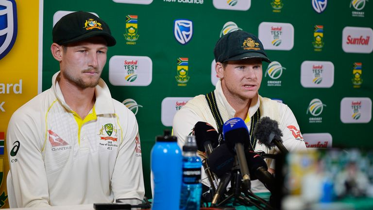 Steve Smith (right) and Cameron Bancroft face the media after Saturday's play in Cape Town