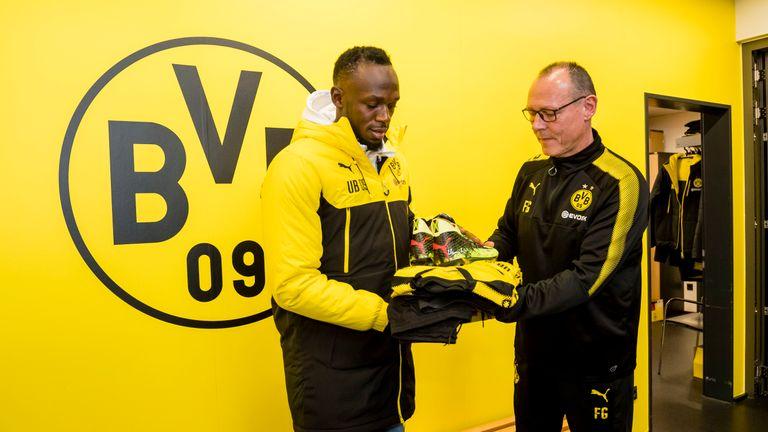 Bolt receives his training gear from Borussia Dortmund kit manager Frank Graefen