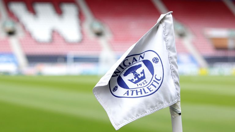 Wigan have been charged by the FA