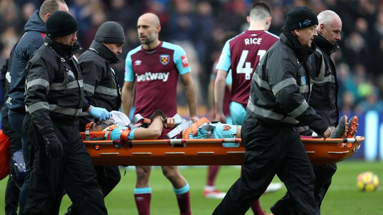 Winston Ried is carried of the pitch on a stretcher after appearing to twist his knee