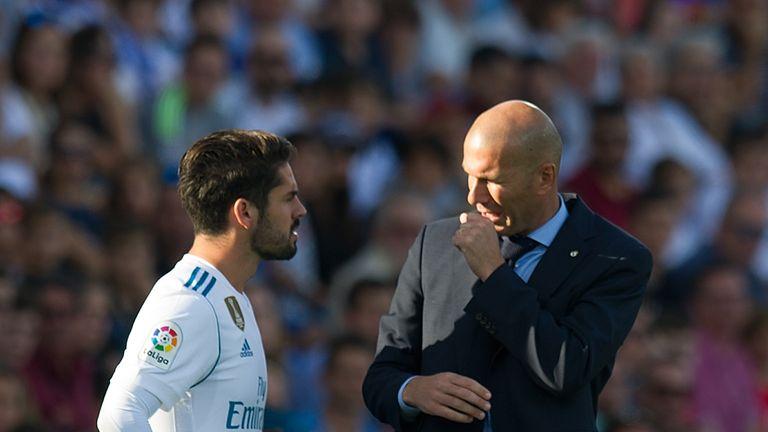 Isco talks with manager Zinedine Zidane