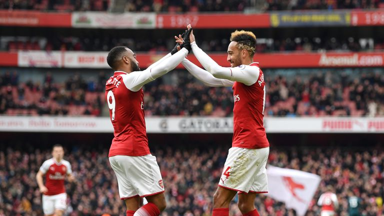 Alexandre Lacazette (L) celebrates a goal with Pierre-Emerick Aubameyang