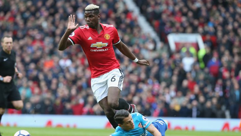 Granit Xhaka slides past Paul Pogba in the build up to United's opener