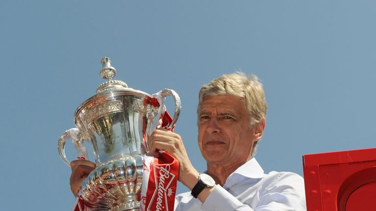 Arsene Wenger celebrates with the FA Cup