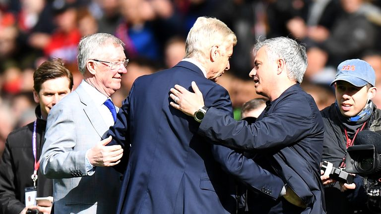 Wenger is greeted by Sir Alex Ferguson and Jose Mourinho at Old Trafford