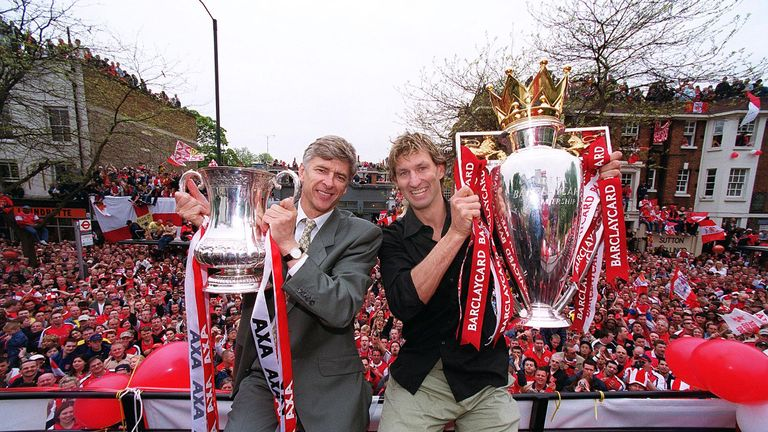 Arsene Wenger with Tony Adams after his side won the double in 2002