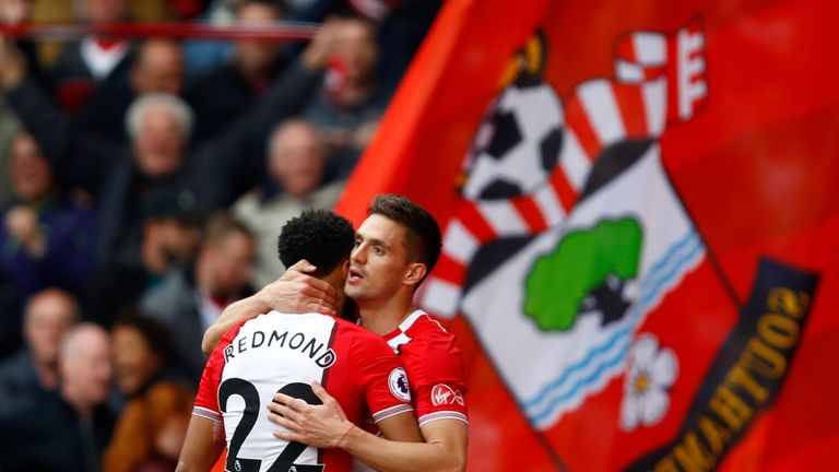 Dusan Tadic celebrates with team-mate Nathan Redmond after opening the scoring against Bournemouth