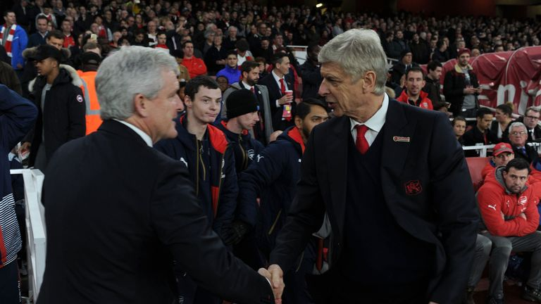 Mark Hughes says the criticism Arsene Wenger has received is unfair