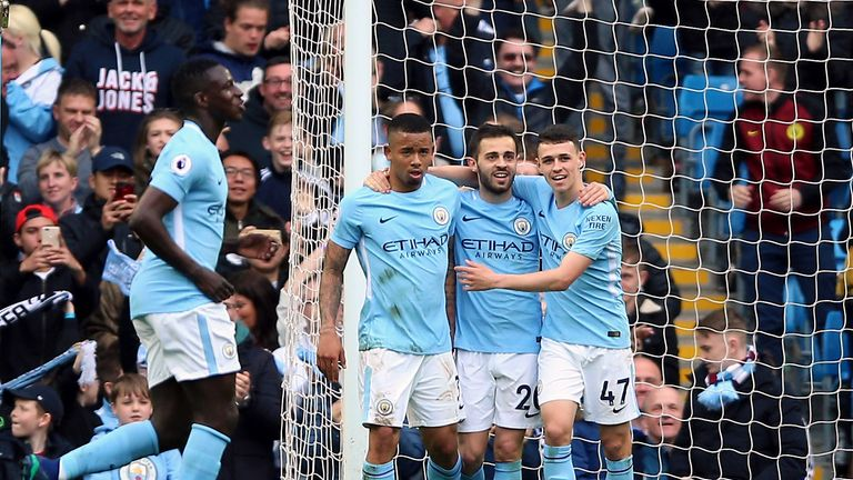 Manchester City's Gabriel Jesus (left) celebrates scoring his side's fifth goal against Swansea