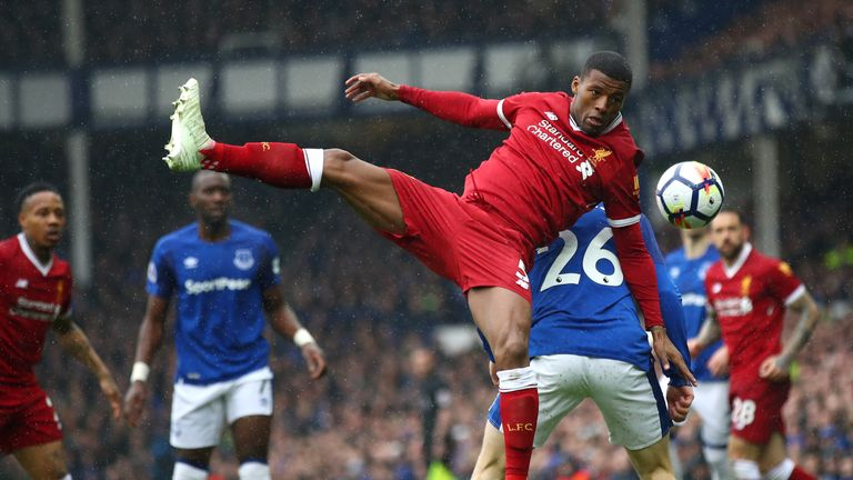 Gini Wijnaldum and Tom Davies compete in the first half at Goodison