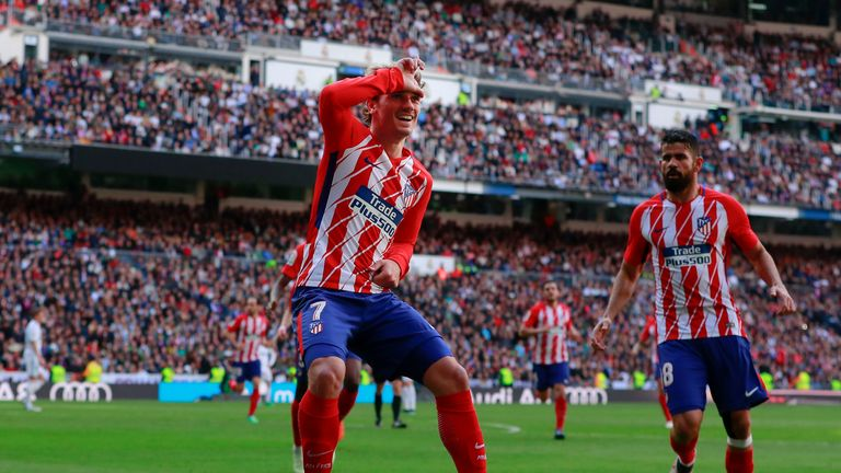 Antoine Griezmann's goal secured a point for Atletico at the Bernabeu