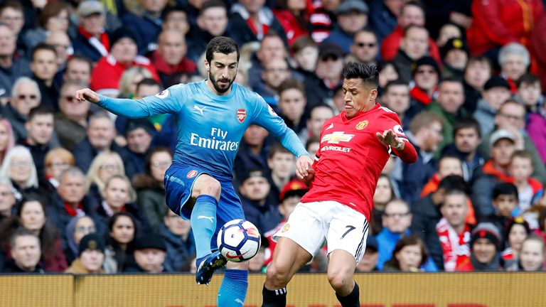Mkhitaryan battles for the ball with Alexis Sanchez