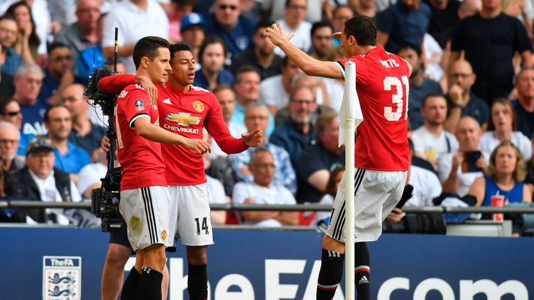 Ander Herrera celebrates with Jesse Lingard and Nemanja Matic after scoring Manchester United's second goal against Tottenham