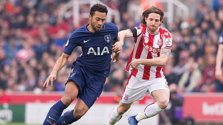 Mousa Dembele and Joe Allen in action during the first half