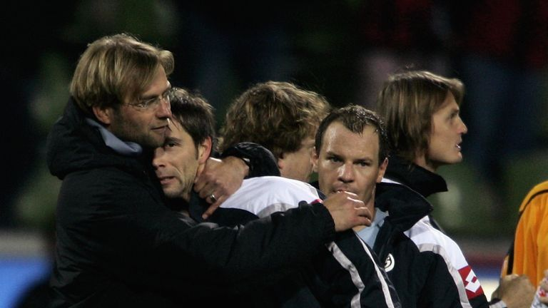 Marco Rose and Jurgen Klopp share a hug during their time together at Mainz