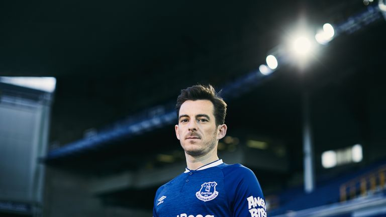 Leighton Baines models Everton's new home strip