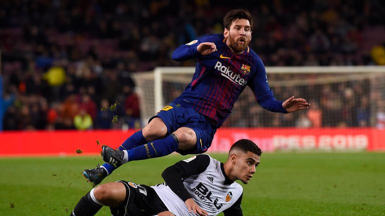 Lionel Messi feels the force of a challenge from Andreas Pereira
