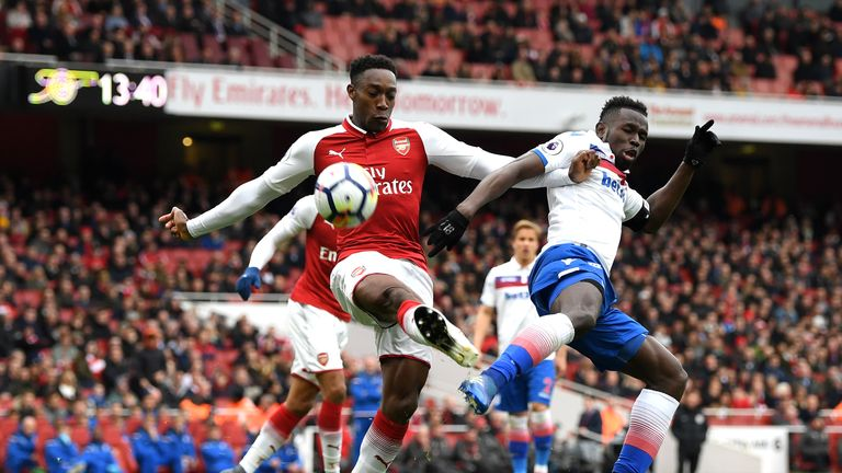 Mame Biram Diouf of Stoke City battles for possession with Arsenal's Danny Welbeck