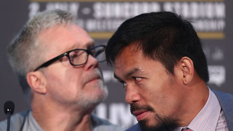 Manny Pacquiao (right) is yet to make a decision on trainer Freddie Roach
