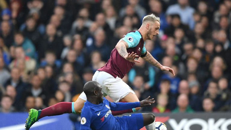 Marko Arnautovic is tackled by N'Golo Kante