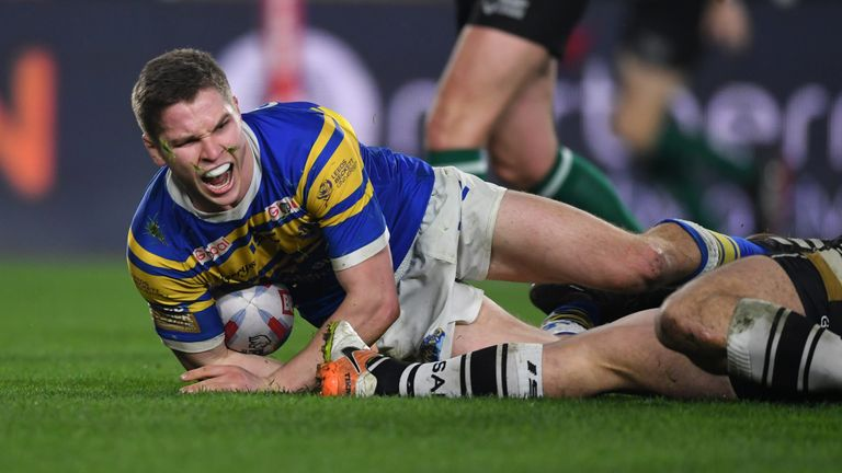 Matt Parcell celebrates after going over for Leeds - a penalty try was eventually awarded